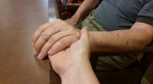 holding hands - caregiving from afar
