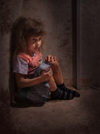 12888135 - child alone in a dark corner