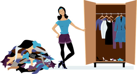 73280988 - woman creating a minimalist wardrobe, purging unnecessary clothes