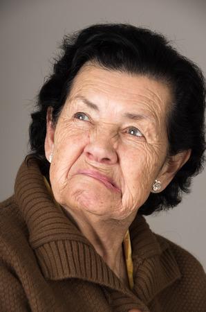36504515 - closeup portrait of old cranky grumpy sad woman grandmother